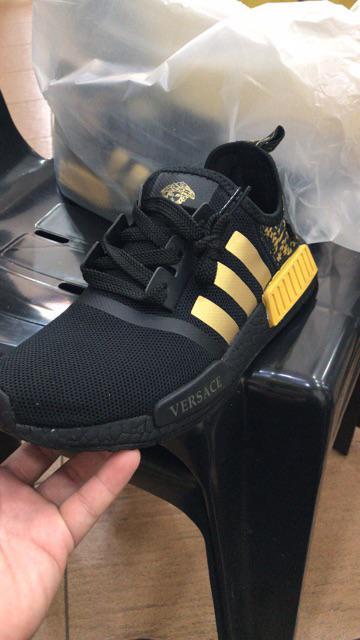832fd0ef0a7 VERSACE x Adidas NMD R1 Black Gold BA7250