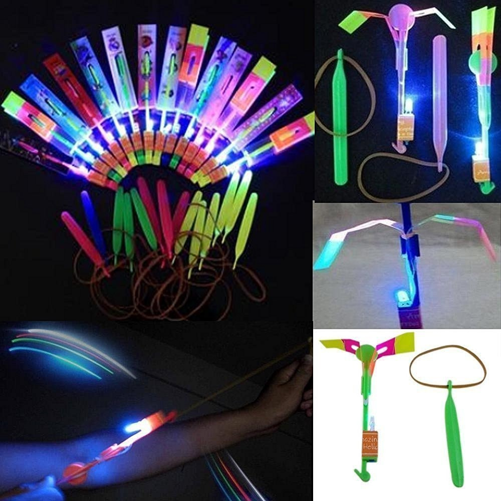 Colorful Amazing Led Light Arrow Rocket Helicopter Flying Toy Party Fun Gift Elastic