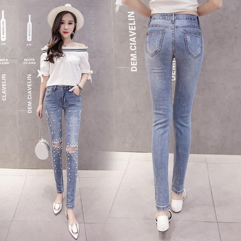 8e02a84139 Spring new personality beaded diamonds hole mahogany jeans women's ...