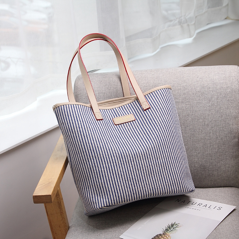 bdc045a1ce4 New Korean version of simple versatile canvas bag white large capacity one  shoulder casual literary tote bag