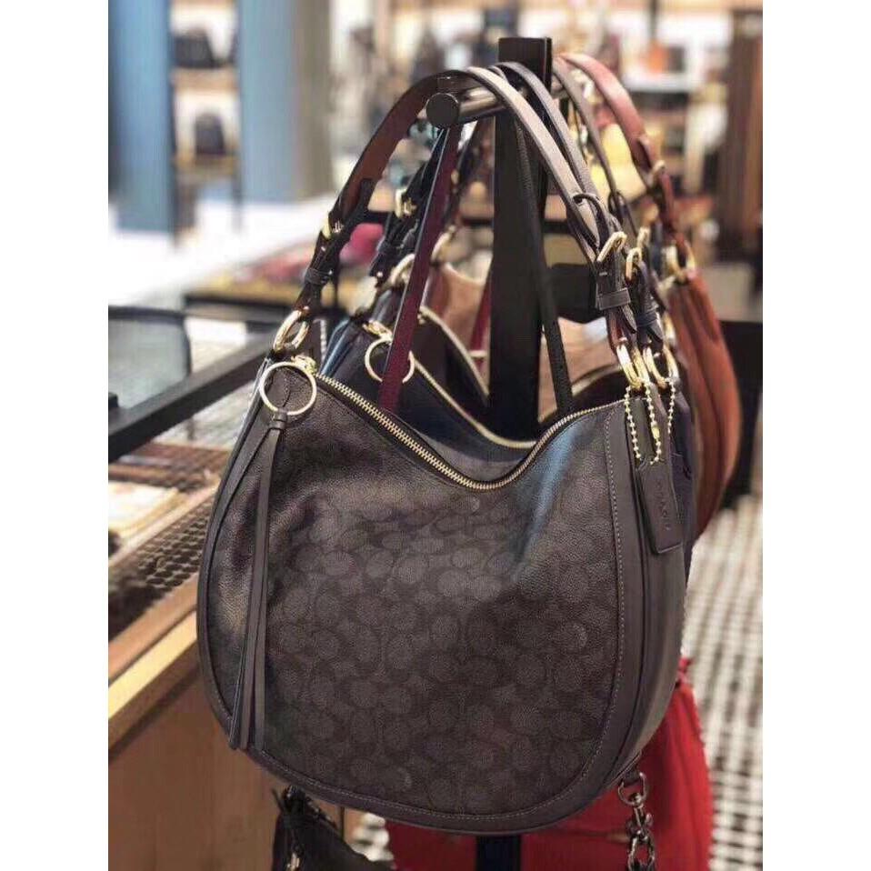 68e1387b9dd7 New Coach38580 printed canvas leather SUTTON half-moon lady bag