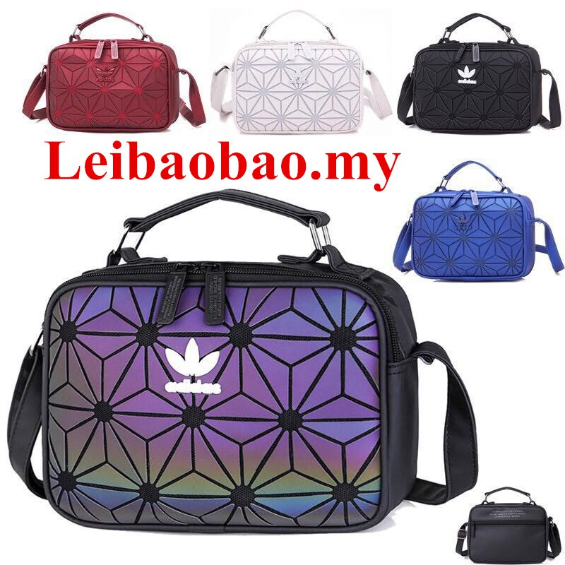 13d15f03152e In Stock ❀ Women s bag new geometric triangle Luminous Color Leather  Backpack