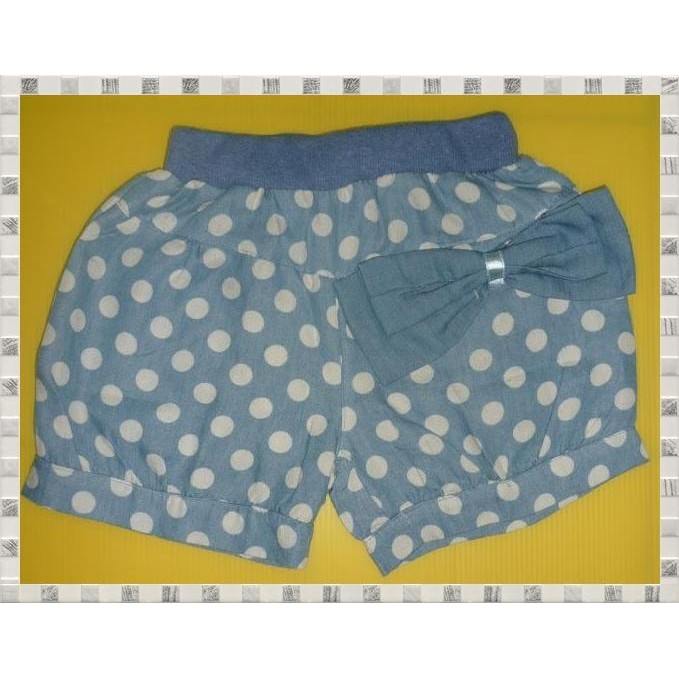 Bermuda Pants features an elastic waistline with polka dots prints and a bow.